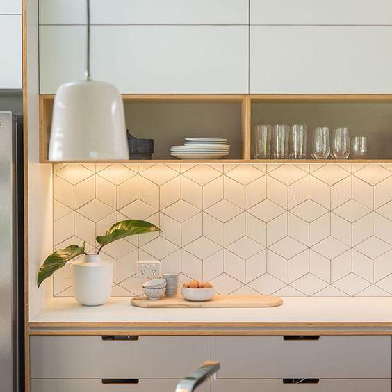 white-geometric-patterned-tile-backsplash
