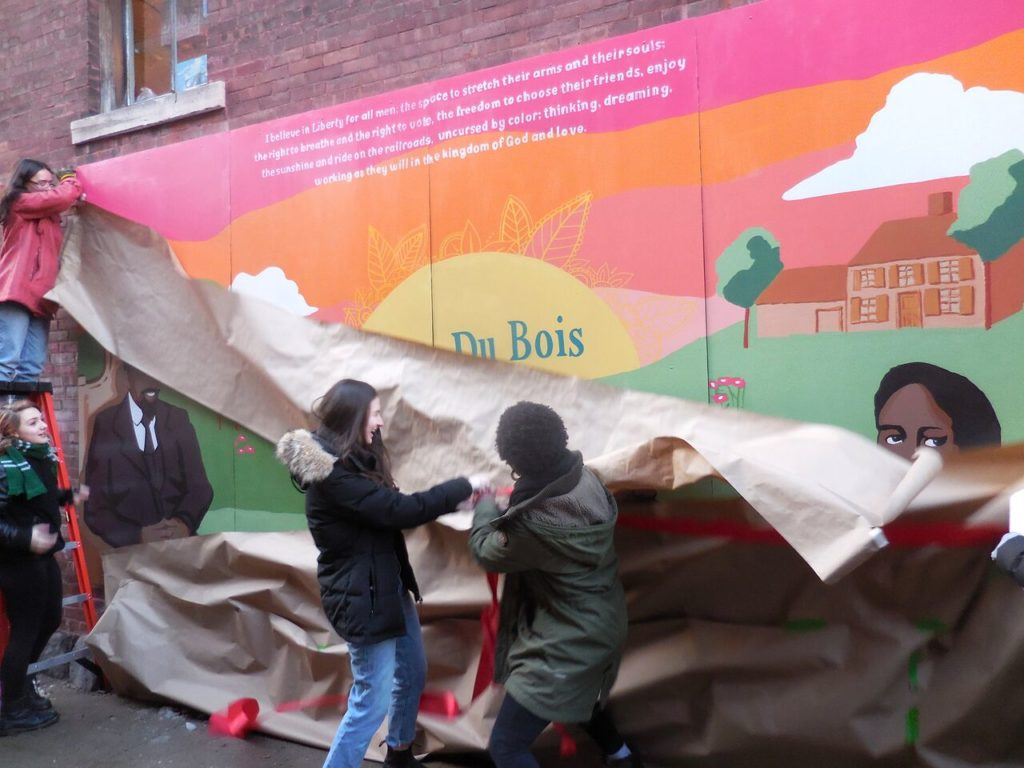 Members of the Railroad Street Youth Project unveil the new W.E.B. Du Bois mural located in the alley between Railroad Street and the Triplex Cinema in Great Barrington.