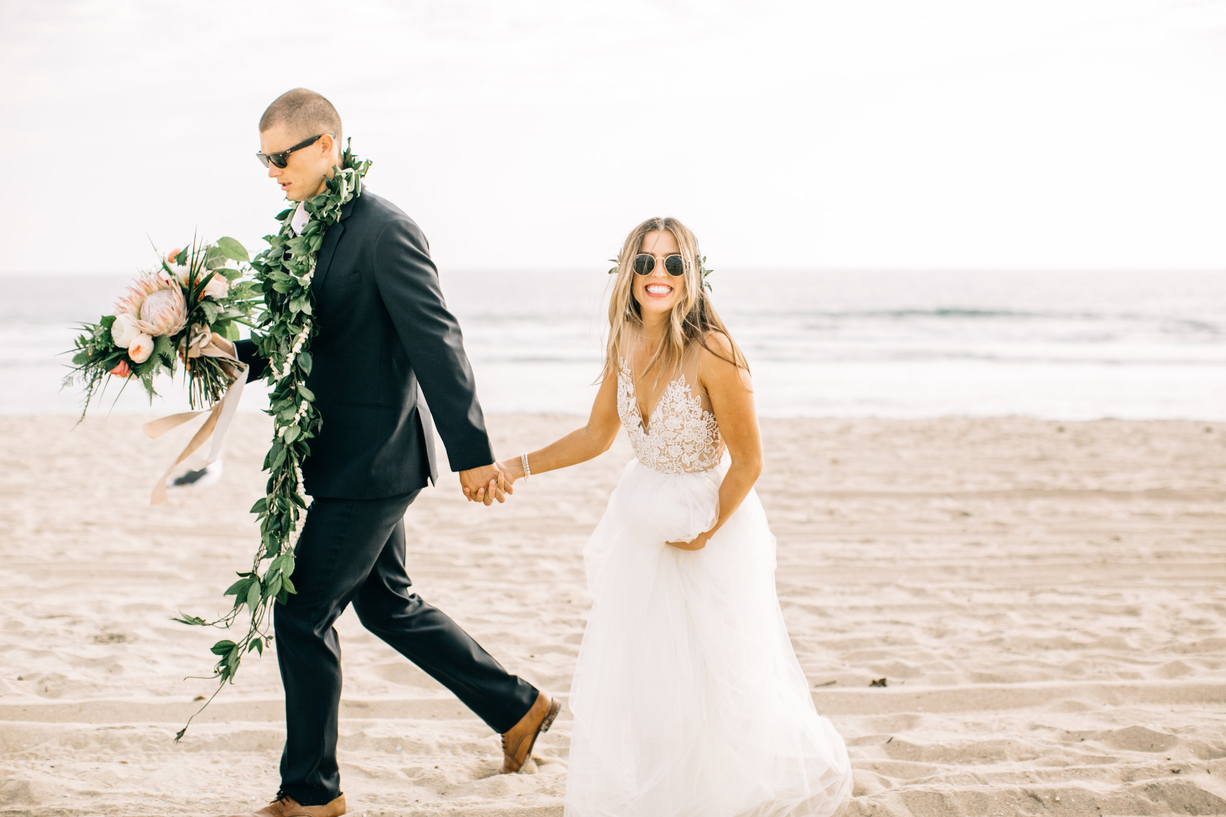 Monica & Tanner wanted a ceremony that truly reflected them, so they found a venue in their hometown of Huntington Beach, California. Monica owns a floral design company and loved creating all the arrangements for her own special day.The couple chose a tropical theme, which was perfect considering Tanner's Hawaiian roots. His sisters and grandmother even performed a traditional hula at the reception!