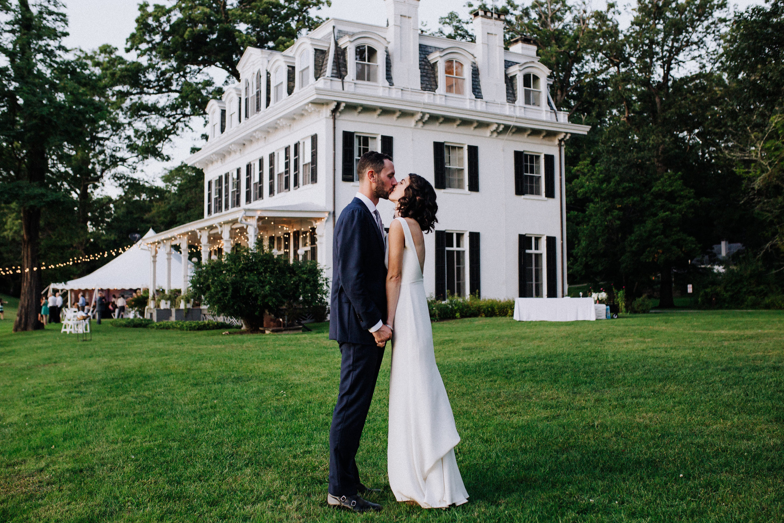The first time Laura & Zach visited Southwood Estate, they knew almost immediately that it was the perfect choice. The couple was blown away by the gorgeous, 1800s era mansion and sprawling views of the Catskills and Hudson River.With no required vendors or rentals on site, Laura & Zach had full creative control of their event. This freedom made it possible to personalize even the tiniest of details. After spending time living in Mexico, Laura developed a slight obsession with the country.She loved being able to work with a local Mexican restaurant to serve margaritas, tacos, even churros during cocktail hour! Everything about the day felt like a true expression of the couple and their community.