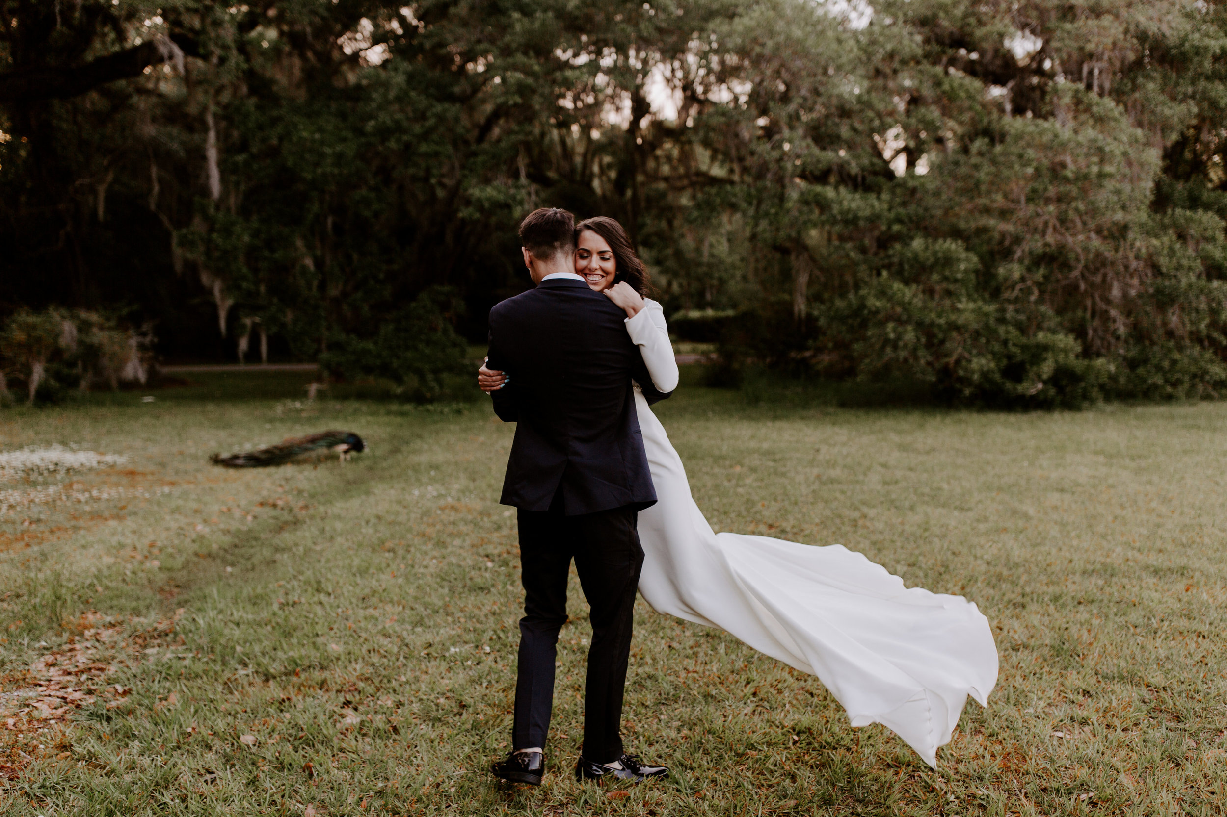 Kayla & Benji wanted their ceremony to feel intimate and really highlight the love they share. The couple decided to elope, with only their immediate family present. Kayla found Magnolia Plantation in Charleston, SC, on Pinterest and immediately knew it was the perfect spot. The tall oak trees covered in Spanish moss gave the venue such a romantic feel, and the couple was able to achieve the sweet fairytale vibe they'd been searching for.