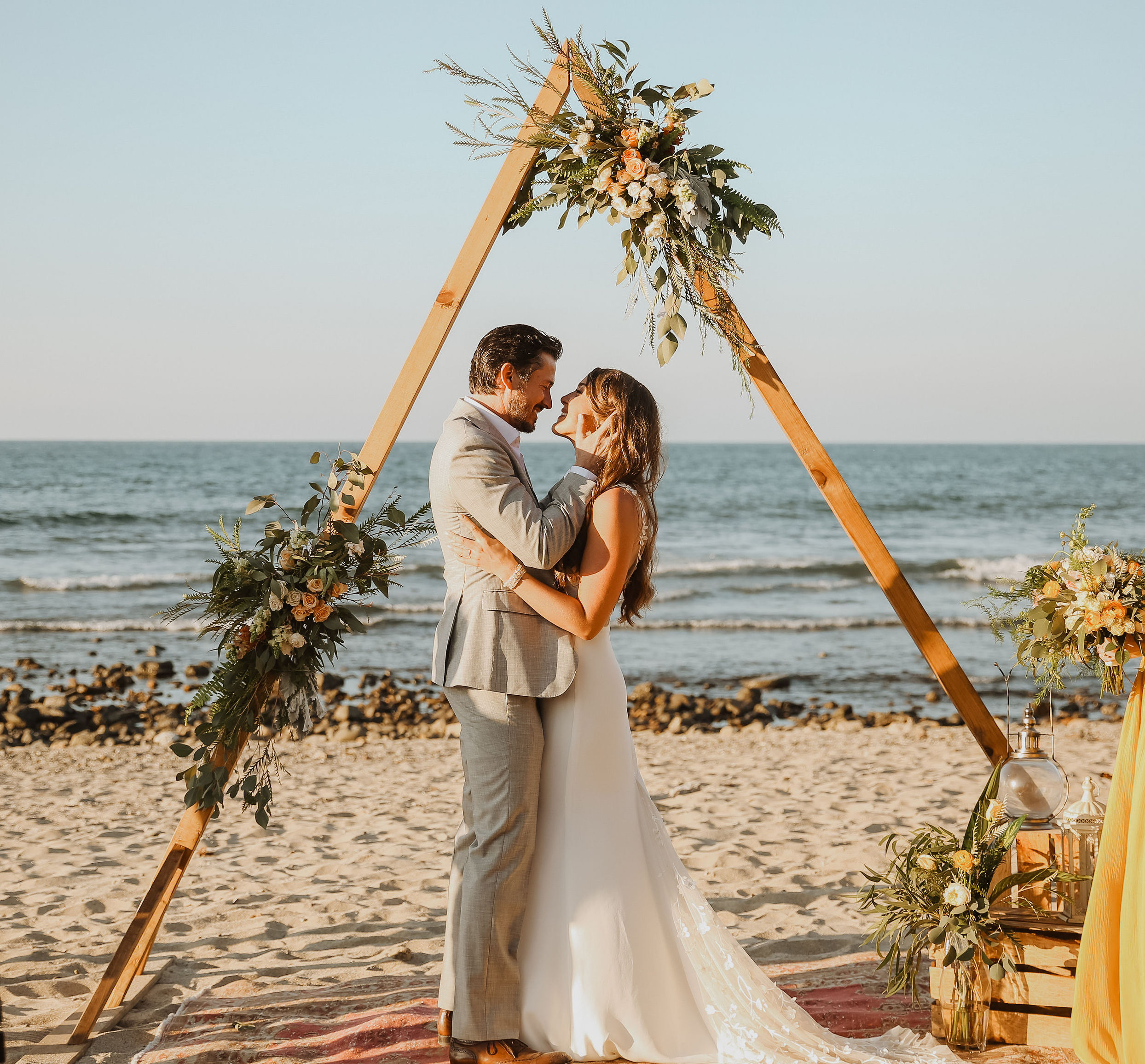 Jamie & Andrew got married in the magical little bohemian town of Sayulita, Mexico. Andrew had taken Jamie there for Christmas a couple years prior and they both immediately knew - this was the place. Andrew's mom passed away a few years ago, and when the venue's only availability happened to be on her birthday, the couple knew it was meant to be. The vibe was barefoot & romantic, with lots of wild greens and garden roses. They flew in rugs from Morocco for the aisle, Jamie's brother officiated, and they each had 3 maids of honor & groomsmen. Throw in a donkey named Leche and popsicles & fresh coconuts for cocktail hour, and the couple had their unconventional, yet perfect day.