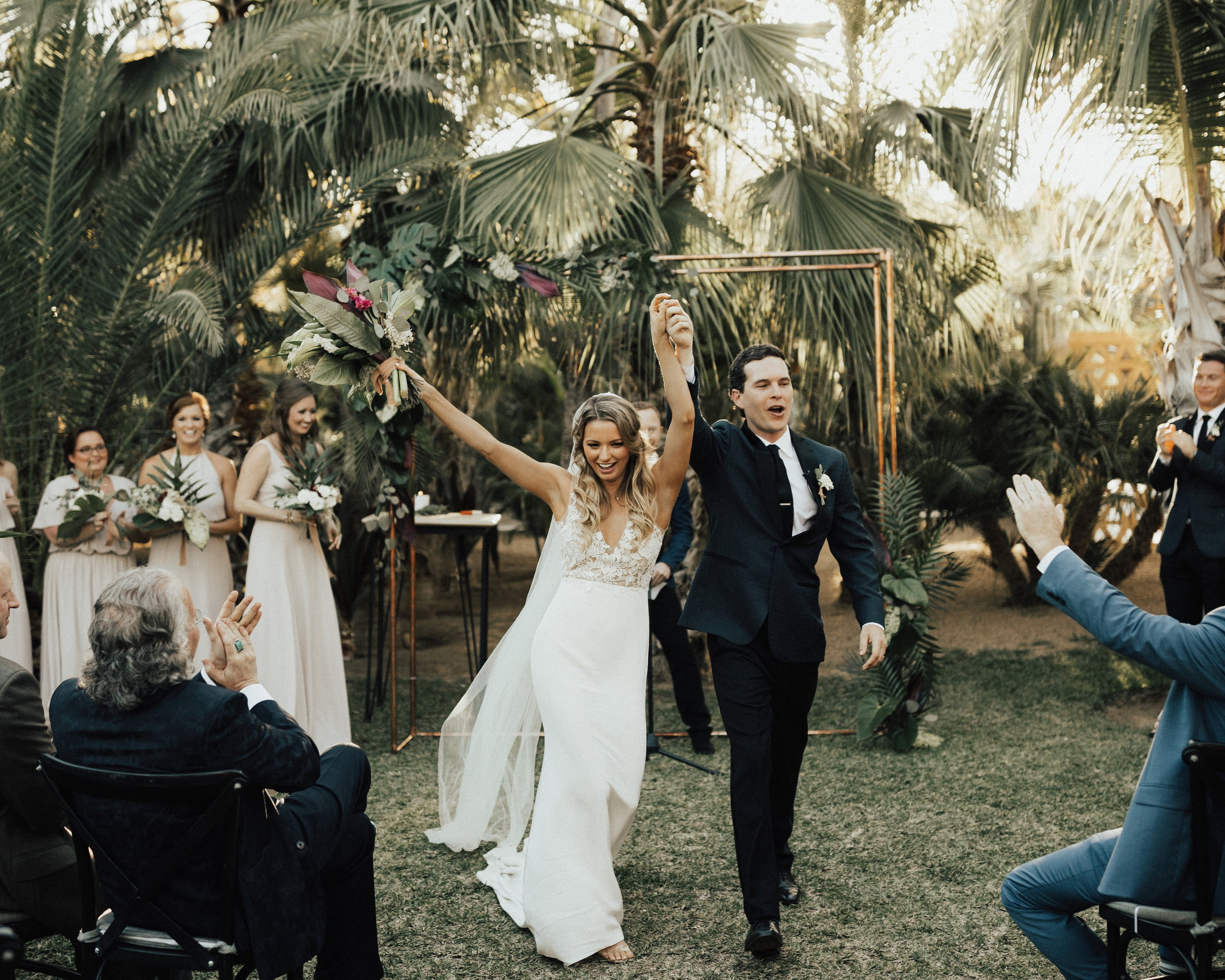 Jamie & Blake's primary focus was finding a venue that was both naturally beautiful and a place where their guests would have an amazing time. Acre Baja in San Jose del Cabo was the perfect location. The space had a farm-to-table restaurant, treehouse resort, and gorgeous wedding venue. It was love at first sight - from the palm tree jungle to the mango orchard that lit up at night. One of their favorite moments was entering the reception through a path lined with family & friends with sparklers. This led into the couple's first dance, featuring a surprise saxophone player to Stevie Wonder's 'For Once in My Life'. It was everything they dreamt of and more.