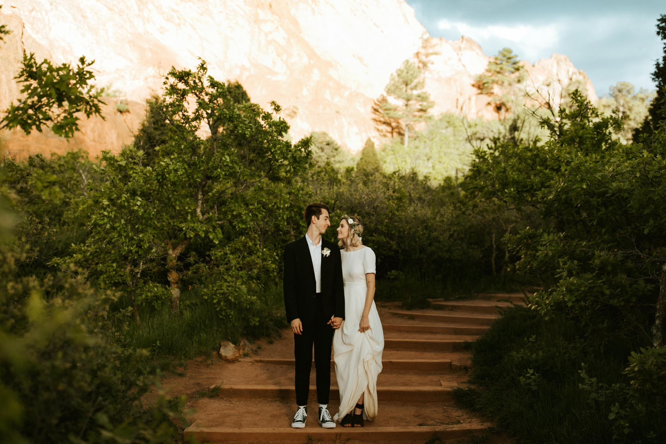 Lindsey & Jacob knew they wanted to have an intimate destination wedding, and eventually decided on Garden of the Gods in Colorado Springs. They wanted to make sure the day was special and as stress-free as possible…only surrounded by best friends and immediate family. Lindsey loved that Jacob chose to wear green PF Flyers - perfect for the day, and perfect for him.