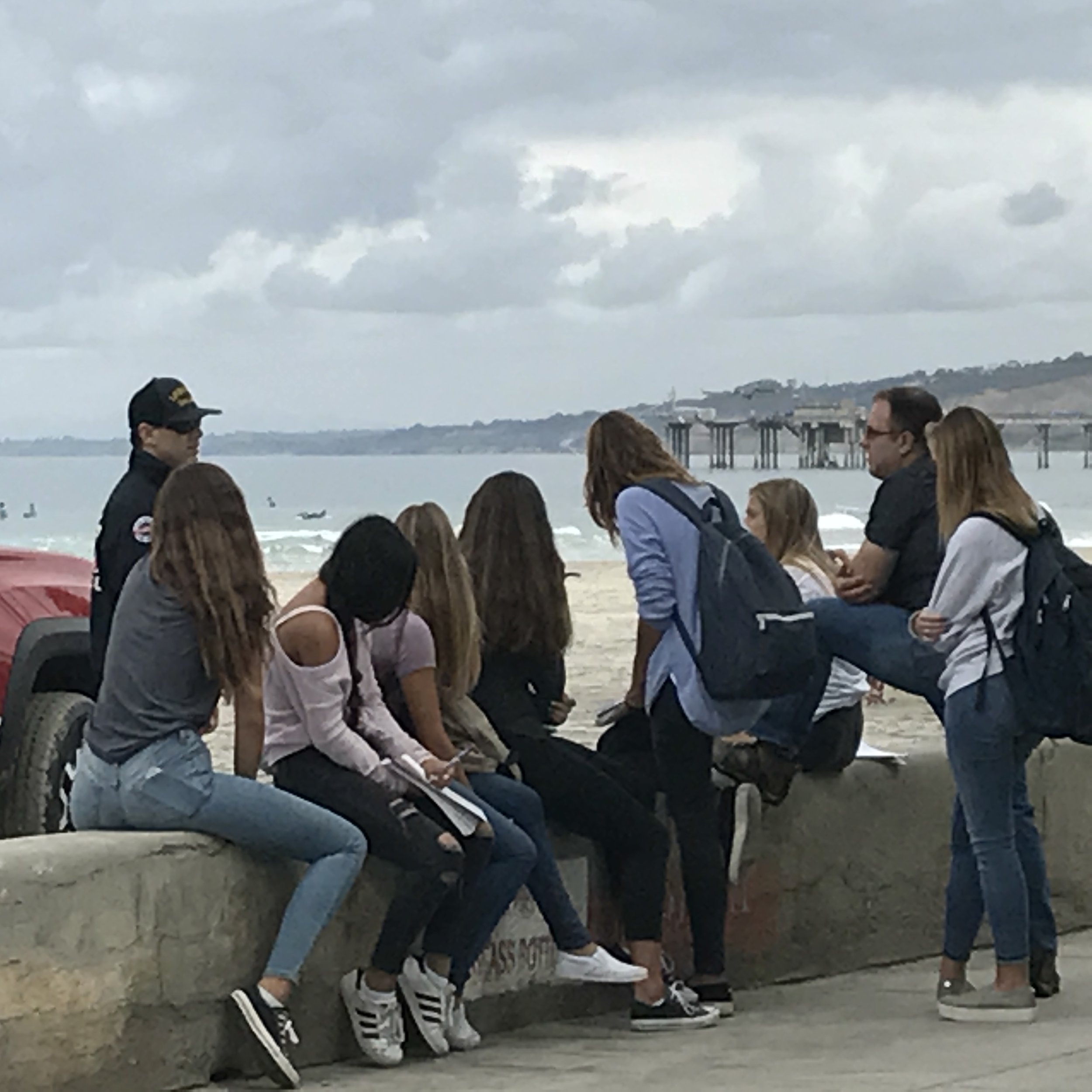 Students conducting ethnographic (in-context) research. Here they are observing and interviewing a lifeguard about some of the challenges existing at the beach.