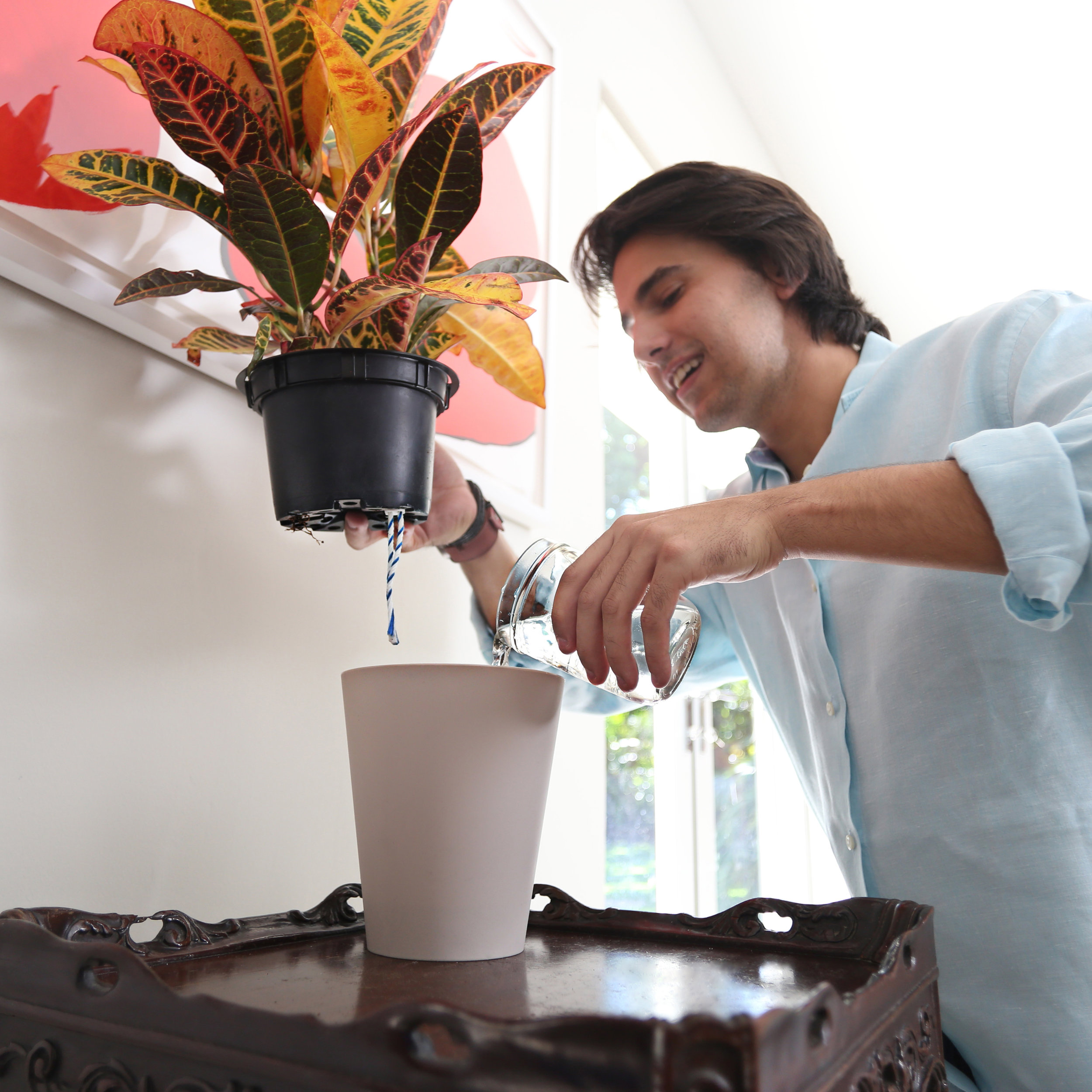 Watering your plants with waterwick is easy -- simply refill the reservoir. It takes only a few seconds and there's no mess!