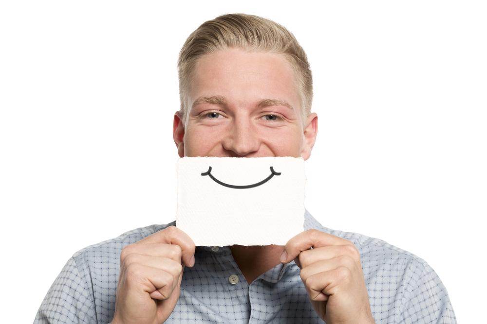 single man holding smile.jpg