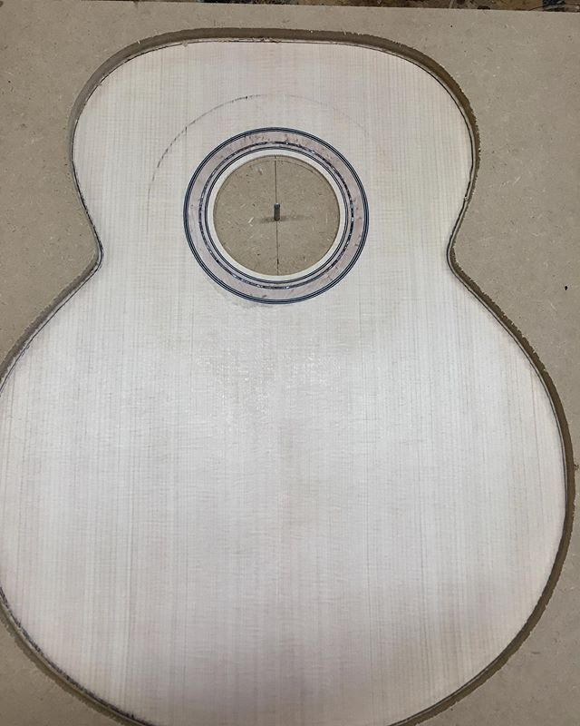Jumbo body with a German spruce top, birdseye maple rosette along with back and sides