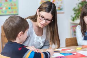 Kindergarten-Teacher-Supports-Child-on-Class-300x200.jpg