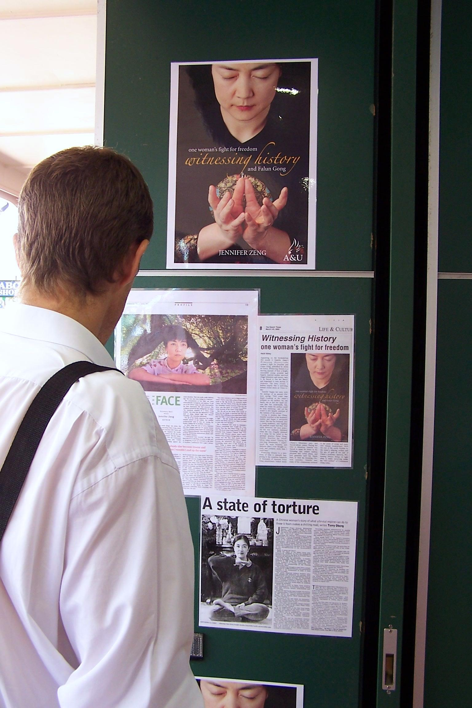 A reader reading media coverage of Jennifer's book at a bookstore in Gold Coast, QLD, Australia in May, 2005