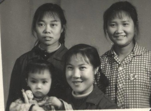 "Jennifer's mother, her two friends and two-year-old Jennifer. As the first child in the family, Jennifer enjoyed some ""special"" treatment such as having a doll of her own. After her two younger sisters were born, her parents no longer had the ability to buy more dolls for her sisters. (Provided by Jennifer Zeng)"