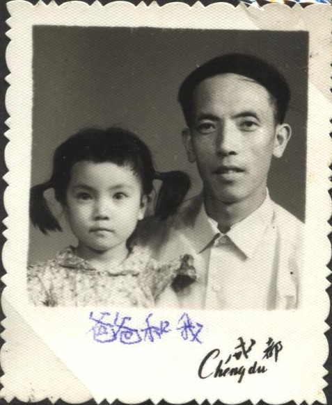 "Jennifer began living with her father when she was four. Her uneven braids and band in this photo were all the ""artistry"" of her father. The dress she wears was also hand-made by her father. Throughout Jennifer's childhood, all the three sisters' clothes were home-made. (Provided by Jennifer Zeng)"