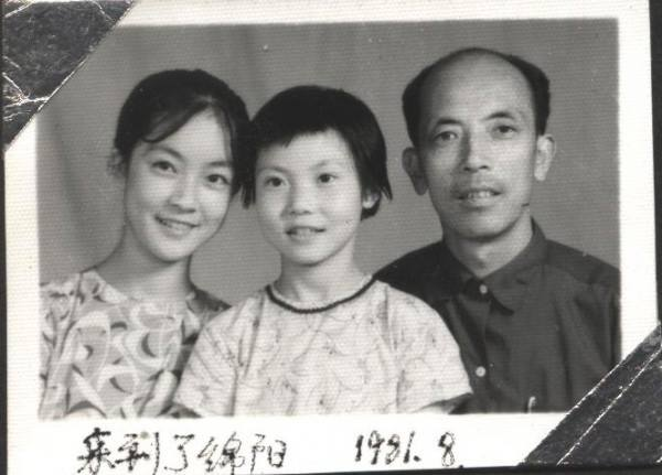 """For the """"bright future"""" of two generations, my family once again split into two parts. My eldest younger sister and I went to Mianyang with my father; whilst my mother and youngest sister stayed at Hanwang. This photo was taken after my father, my eldest younger sister and I moved to Mianyang in August 1981.為了兩代人的前途,我們的家再次被拆為兩個,我和大妹妹跟隨父親來到綿陽。這是剛到綿陽時的合影。"""