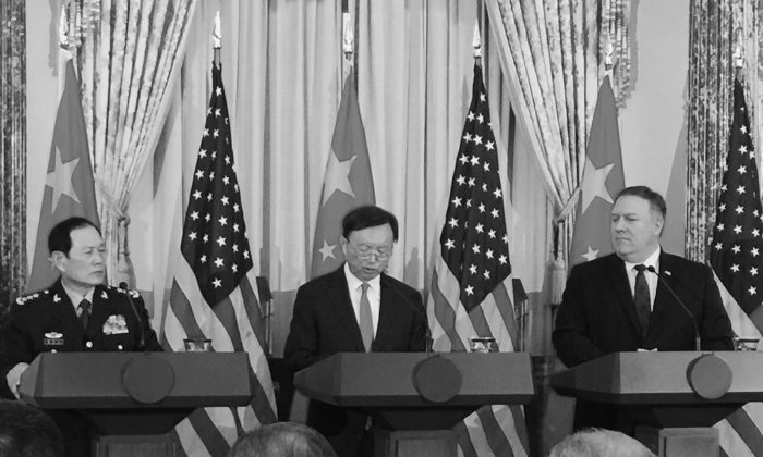 Director of the Office of Foreign Affairs Yang Jiechi (C) reads from a script in answer to a question at the U.S.-China Diplomatic Security Dialogue in Washington on Nov. 9, 2018. (Jennifer Zeng/The Epoch Times)