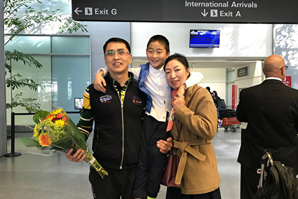 Yu Ming is greeted by his wife and son at San Francisco International Airport on Jan. 27, 2019. (The Epoch Times)