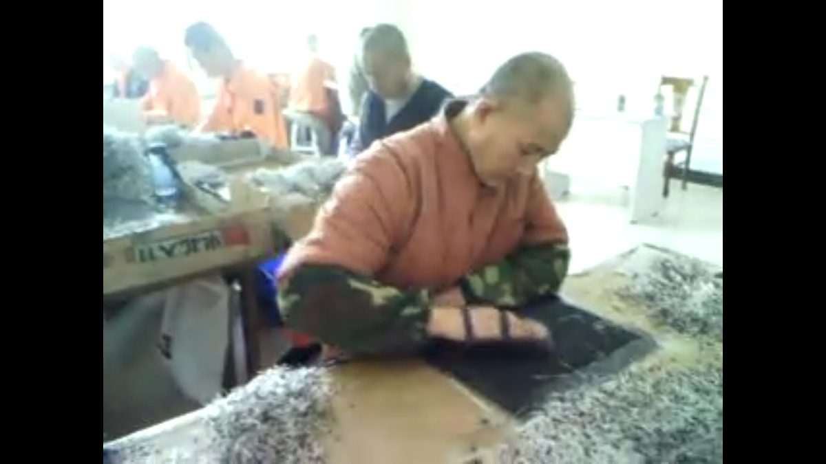 Undercover footage from the Masanjia labor camp in China showing inmates making diodes during the 2008 Beijing Olympics. (Courtesy of Yu Ming)