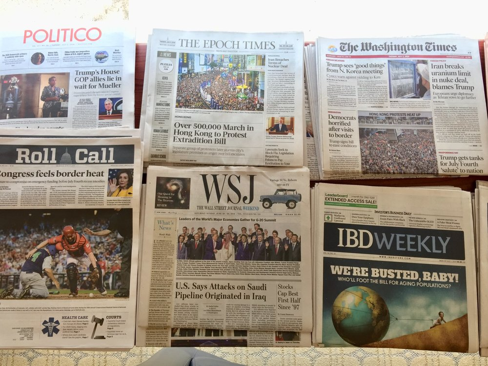 Front pages of different English language newspapers display at the National Press Club on July 2, 2019