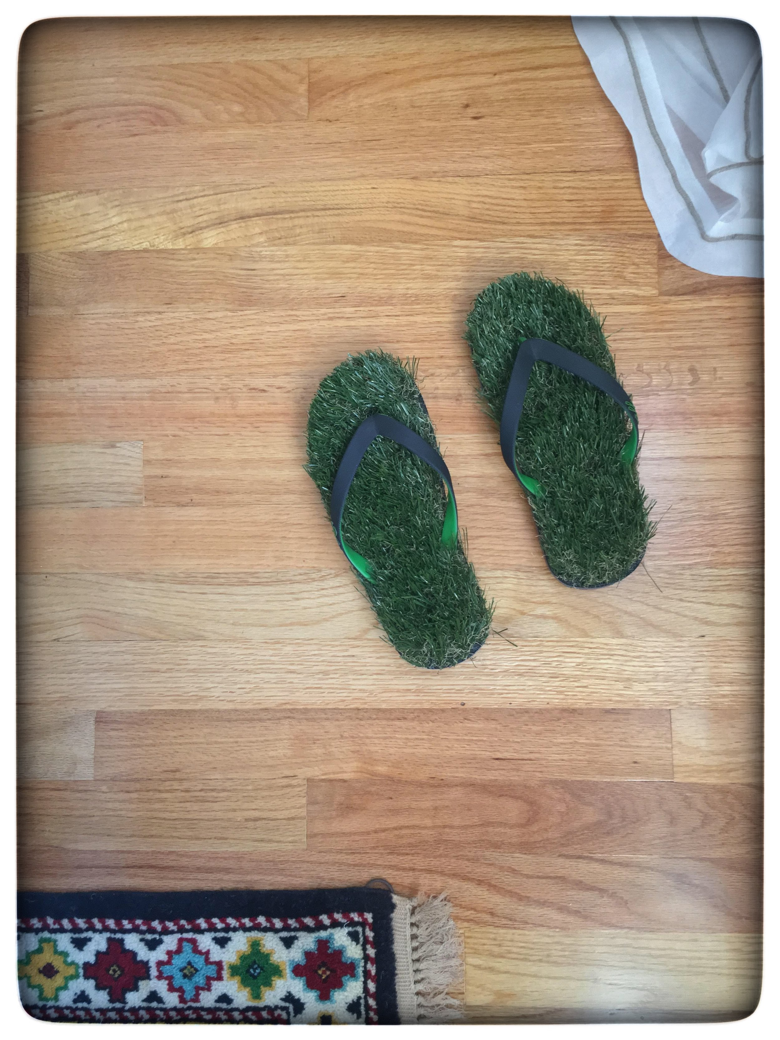 bringing nature in - Of course it wouldn't be a room by me if I didn't add a touch of whimsy. As if the hotel bell on the nightstand was not enough for some laughs, I just had to get these grass flip flops and you know what, it's been a great hit with those who have seen the room in person. Why not have a little fun every now and then, right? Had a blast creating the fresh flower arrangements for this challenge and the room smells fantastic! And as we all know it's always great to kick your shoes off once in a while and walk in the grass even if it's inside.