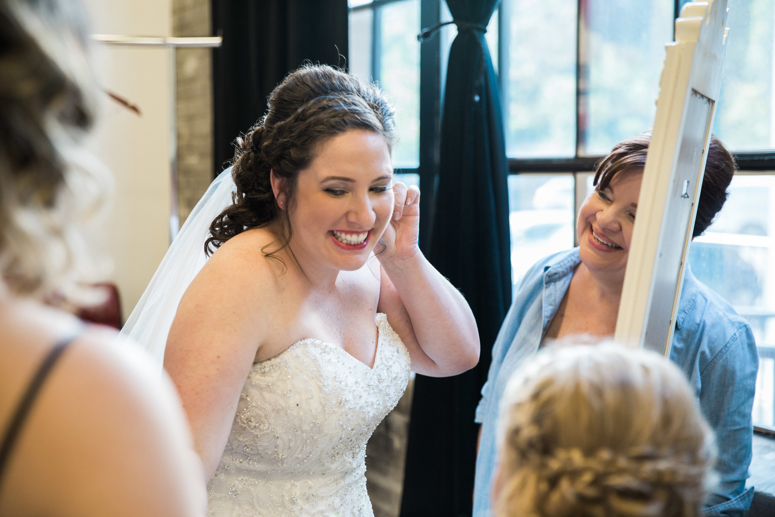 Smiling Bride Getting Ready_Tania Howard Photography.jpg