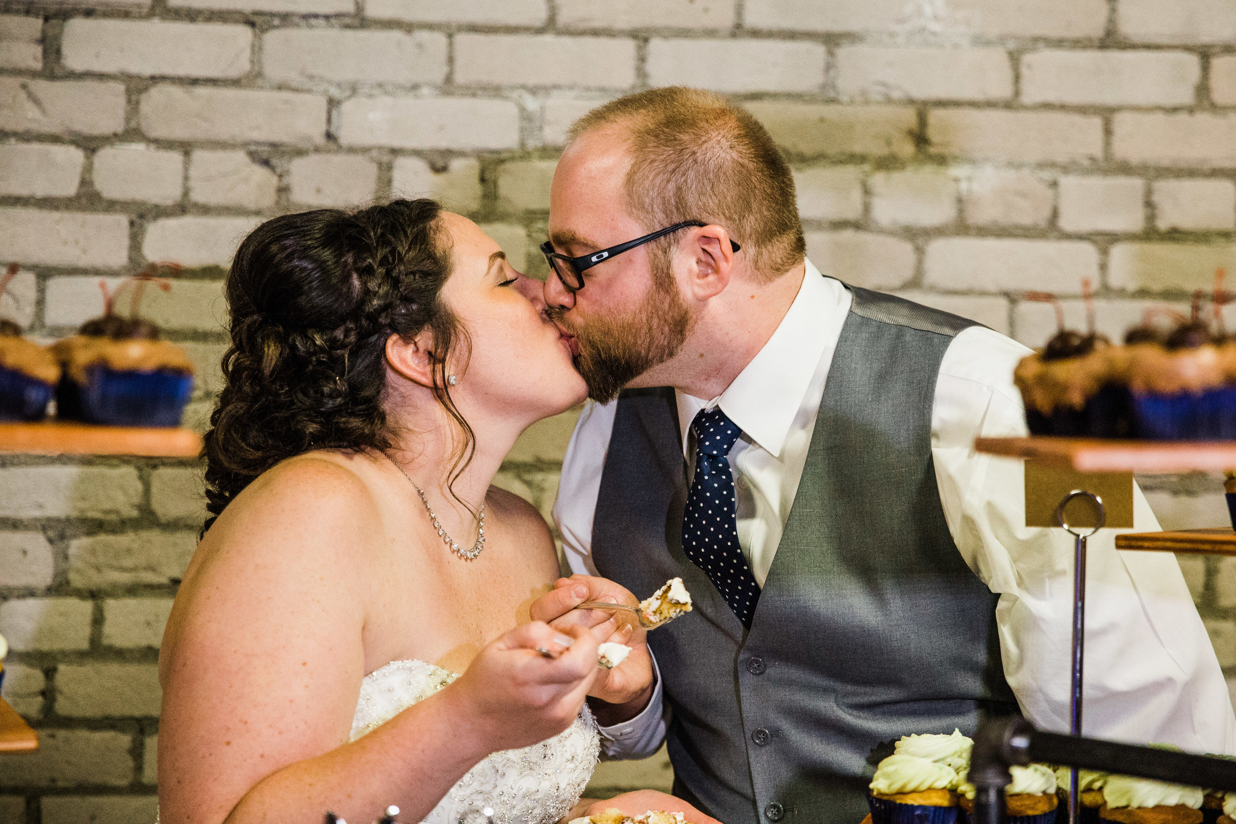 Grand Rapids Wedding Cake Kiss_Tania Howard Photography.jpg