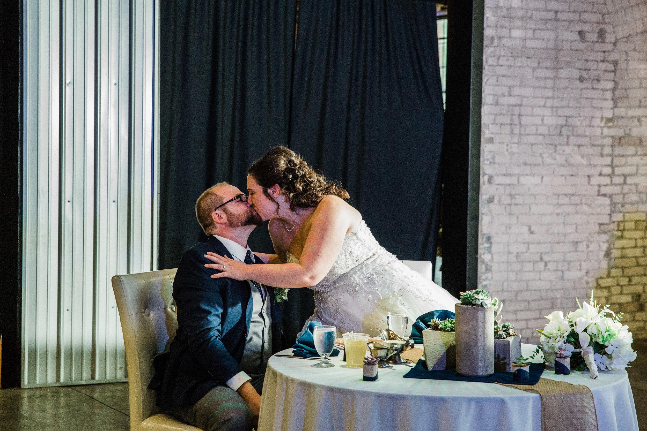 Michigan Bride and Groom Kissing at Wedding Reception_Tania Howard Photography.jpg