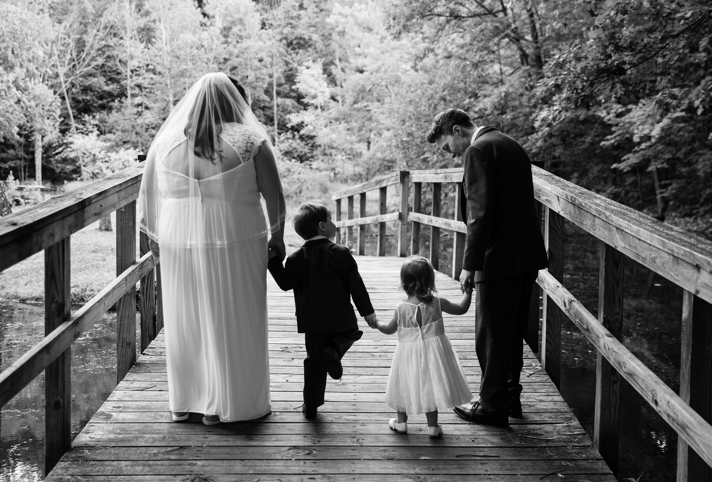 Lansing Michigan Bride and Groom with Happy Family B&W_Tania Howard Photography.jpg