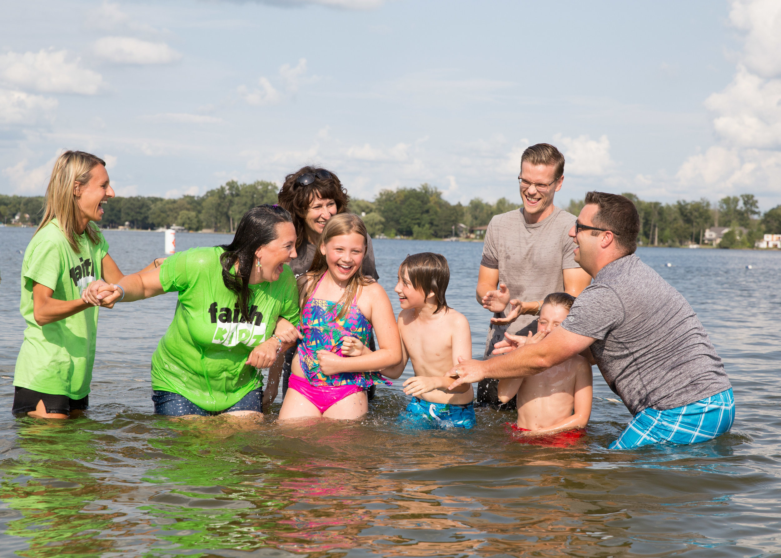 Outdoor whole-family baptism at Lake Lansing Park South.