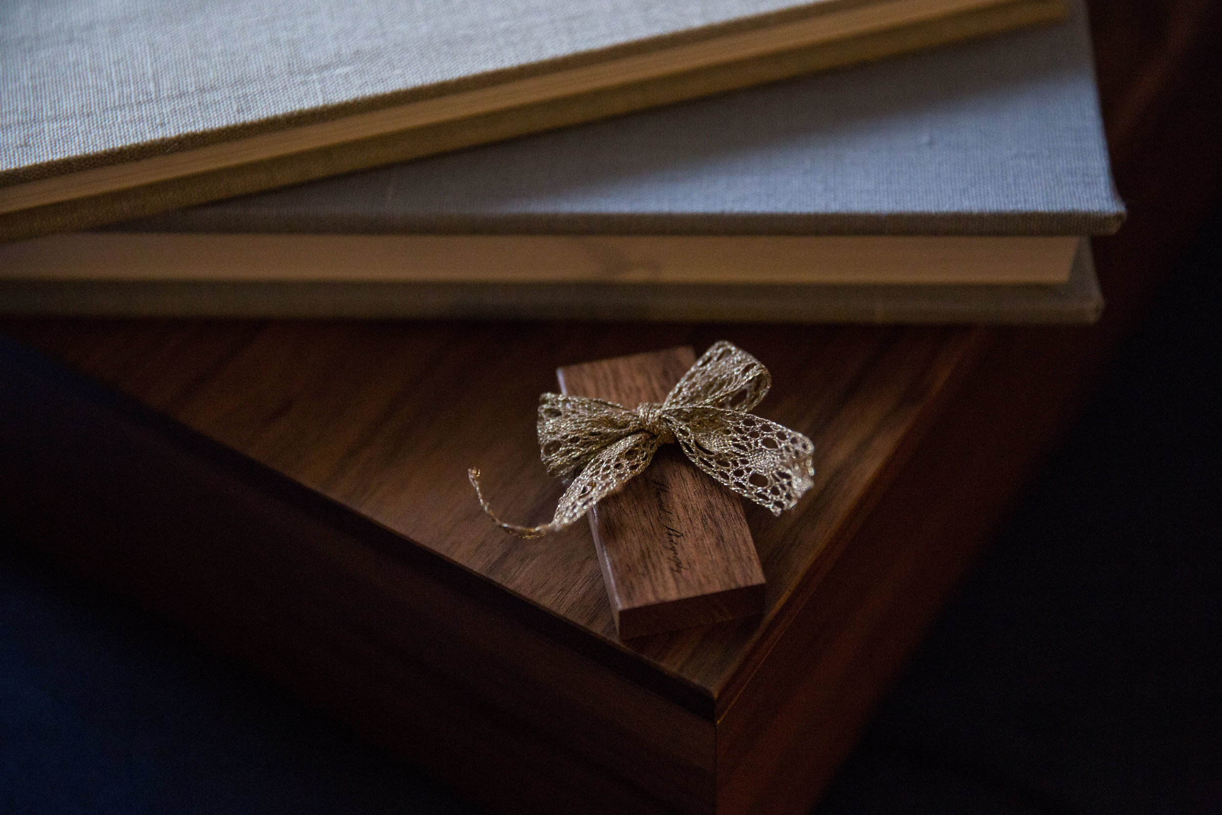 If your session includes digital images, they will be provided on a wooden USB with a copy of your print release.