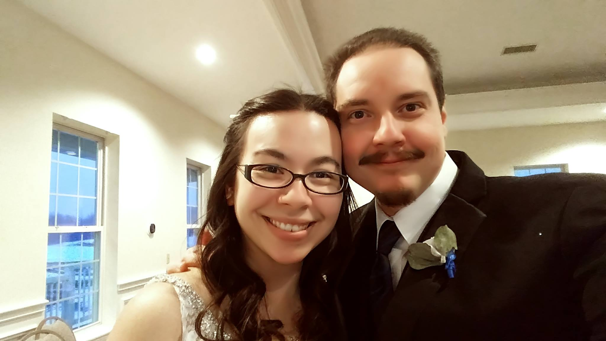 Me with my husband Jonathan on our wedding night. Yes, it's a selfie, but this photo will always be one of my personal favorites, because look at those smiles. :)