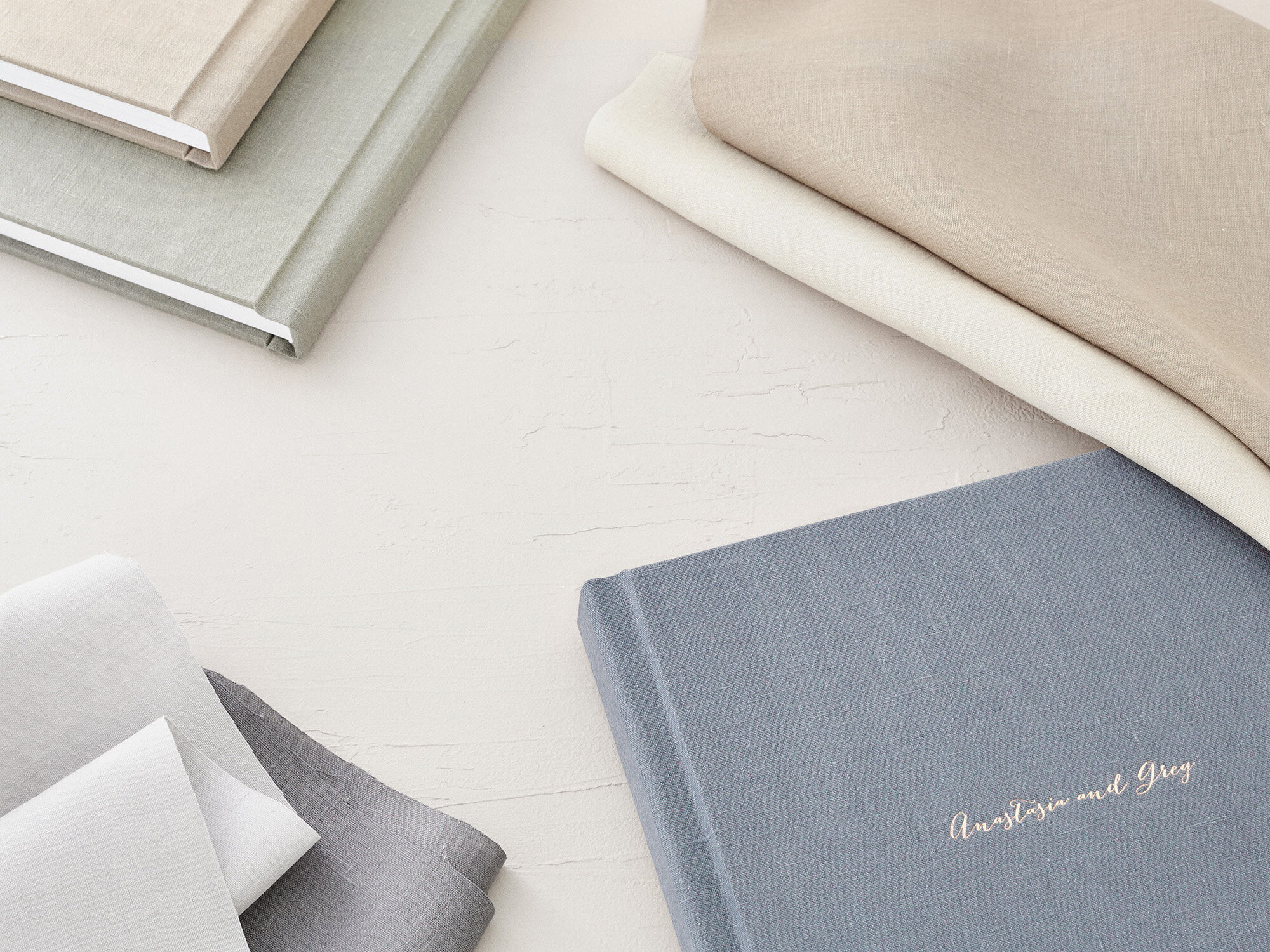 "Linen albums have the additional options of gold, silver, or rose gold foil debossing, in addition to standard ""blind"" debossing (no color added)."