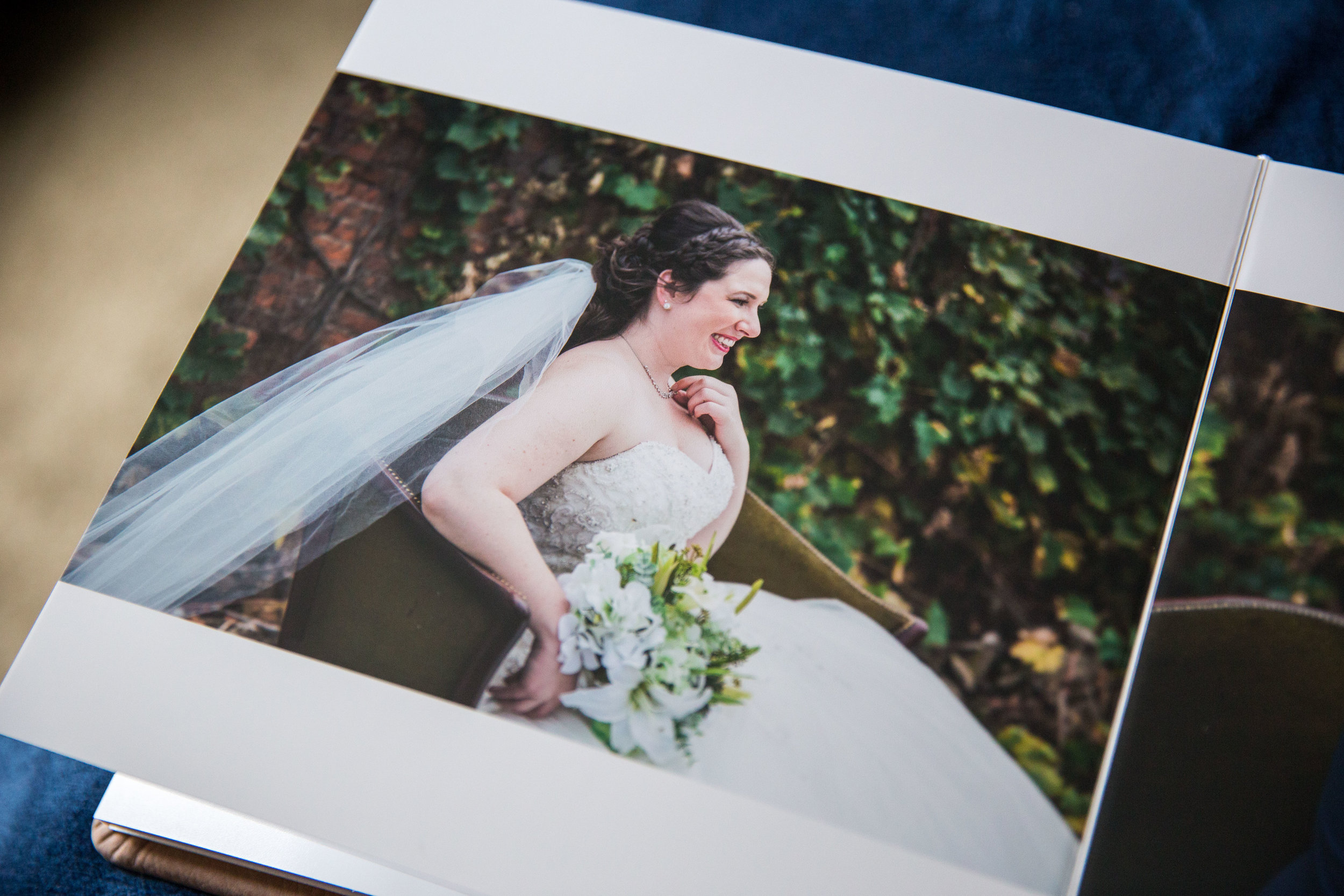 """A Grand Rapids bride beaming with joy on her wedding day. Shown in a 10"""" x 10"""" premium leather album."""