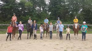 Volunteers with horses.jpg