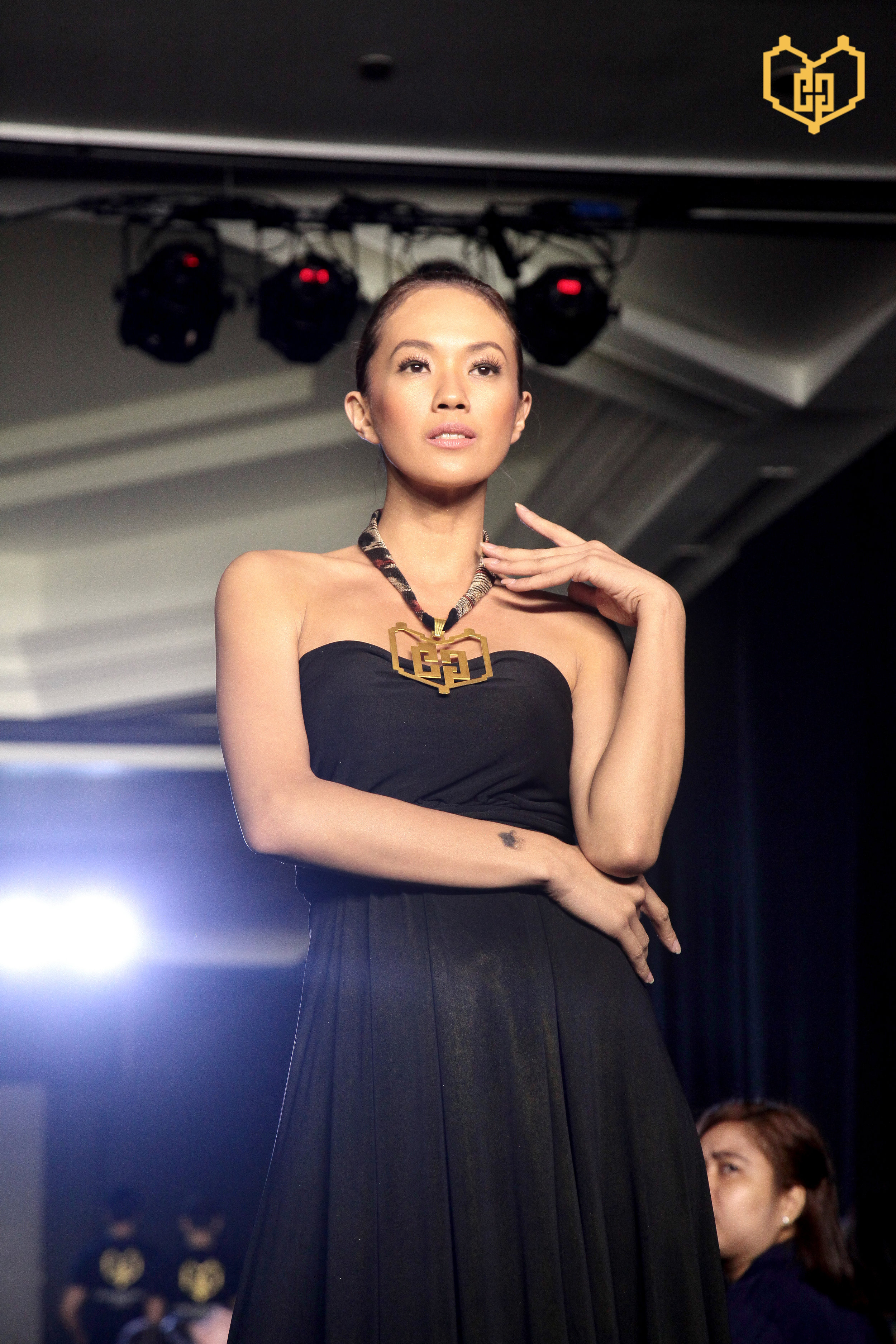 Female model showcases the Compassionate Gold emblem pendant in a T'nalak necklace in the recently-held launching.