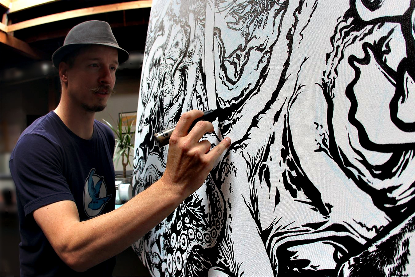 Founder of the Planet Labs Artist in Residence program, Forest Stearns creating the first art show in space one painting at a time. PC:Planet