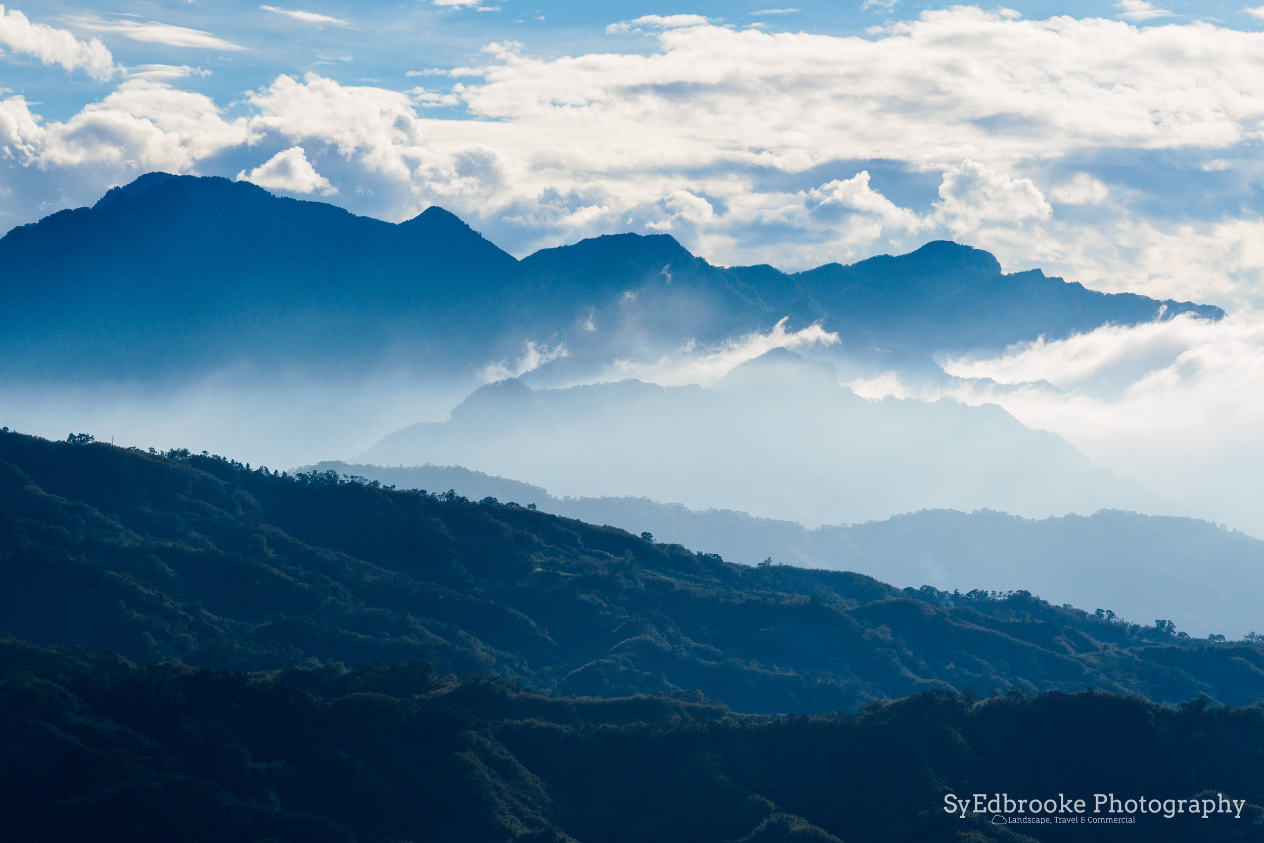 I shot this with my 75mm prime lens, The cloud and mist caught my eye. f4.5, ISO 200, 1/1600, 75mm