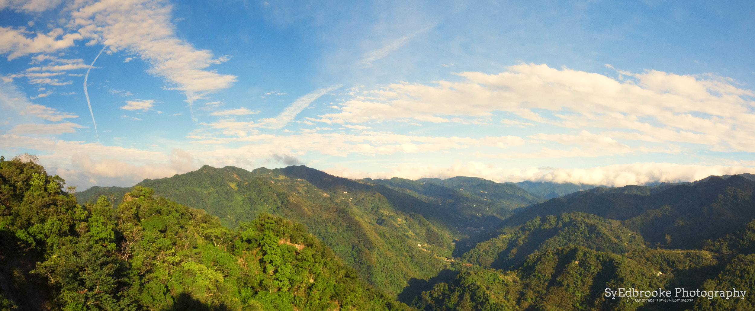 a panoramic shot of the valley stretching into the distance mountains. f22, ISO 640, 1/60, 24mm