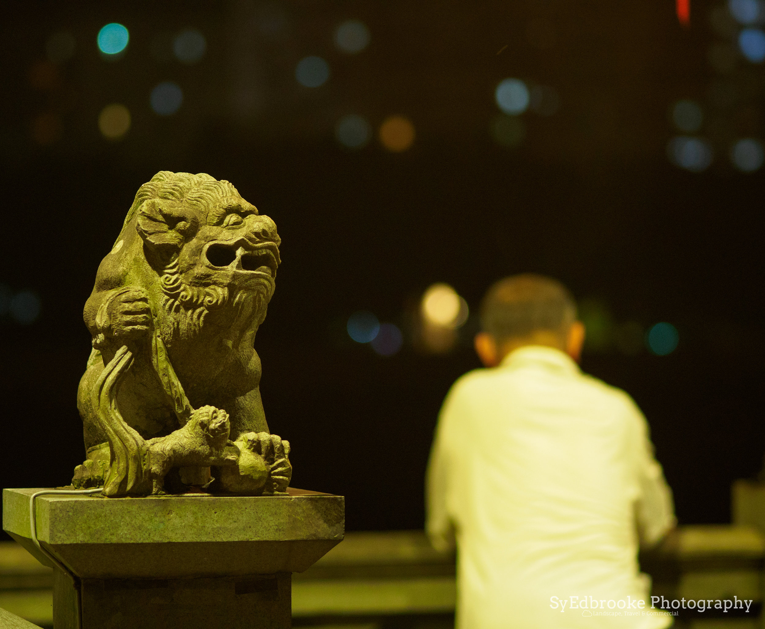 A local relaxing on a hot summer night. f1.8, ISO 1600, 1/30, 17mm