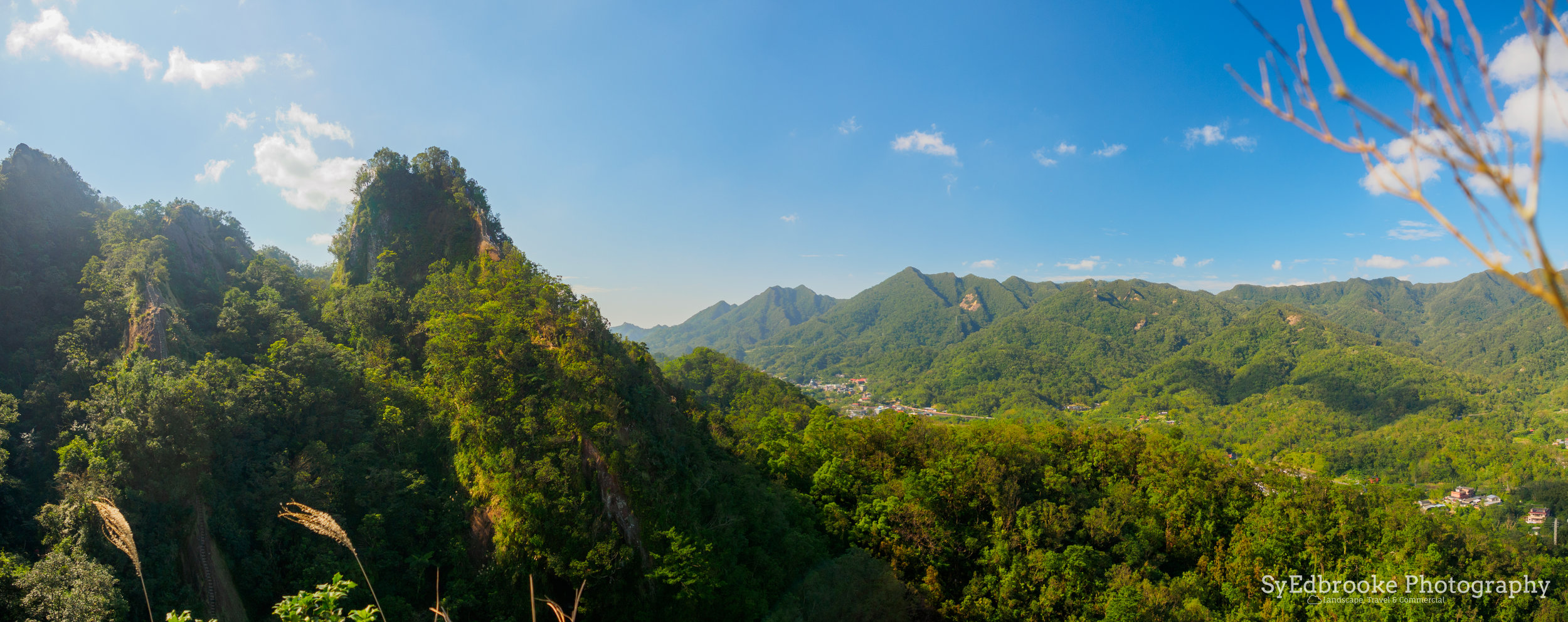 the two peaks as seen from Xiaozi. f3.5 ISO 200, 1/500, 24mm (stitched)