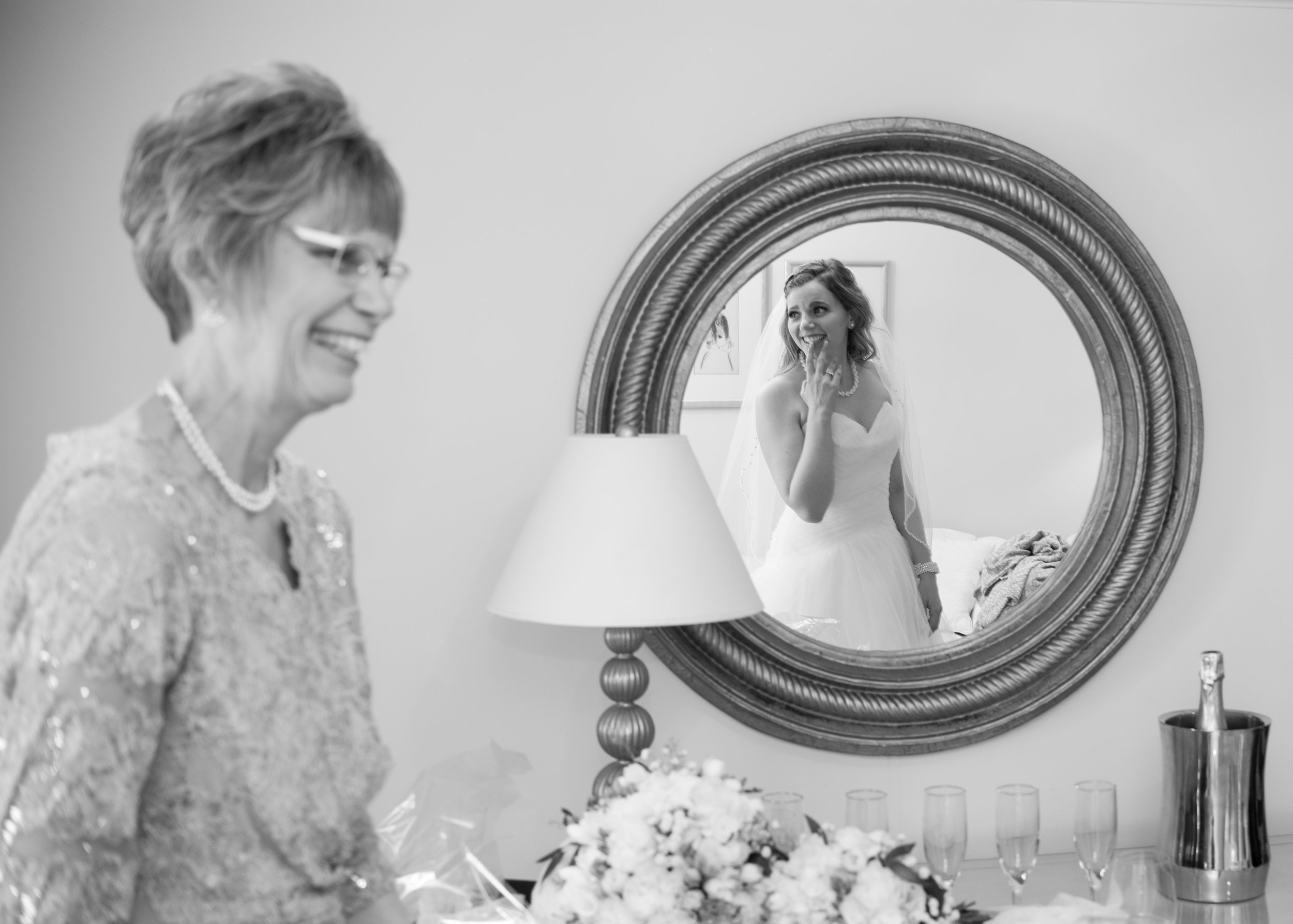 A Bride and her Mother Getting Ready on her Wedding Day