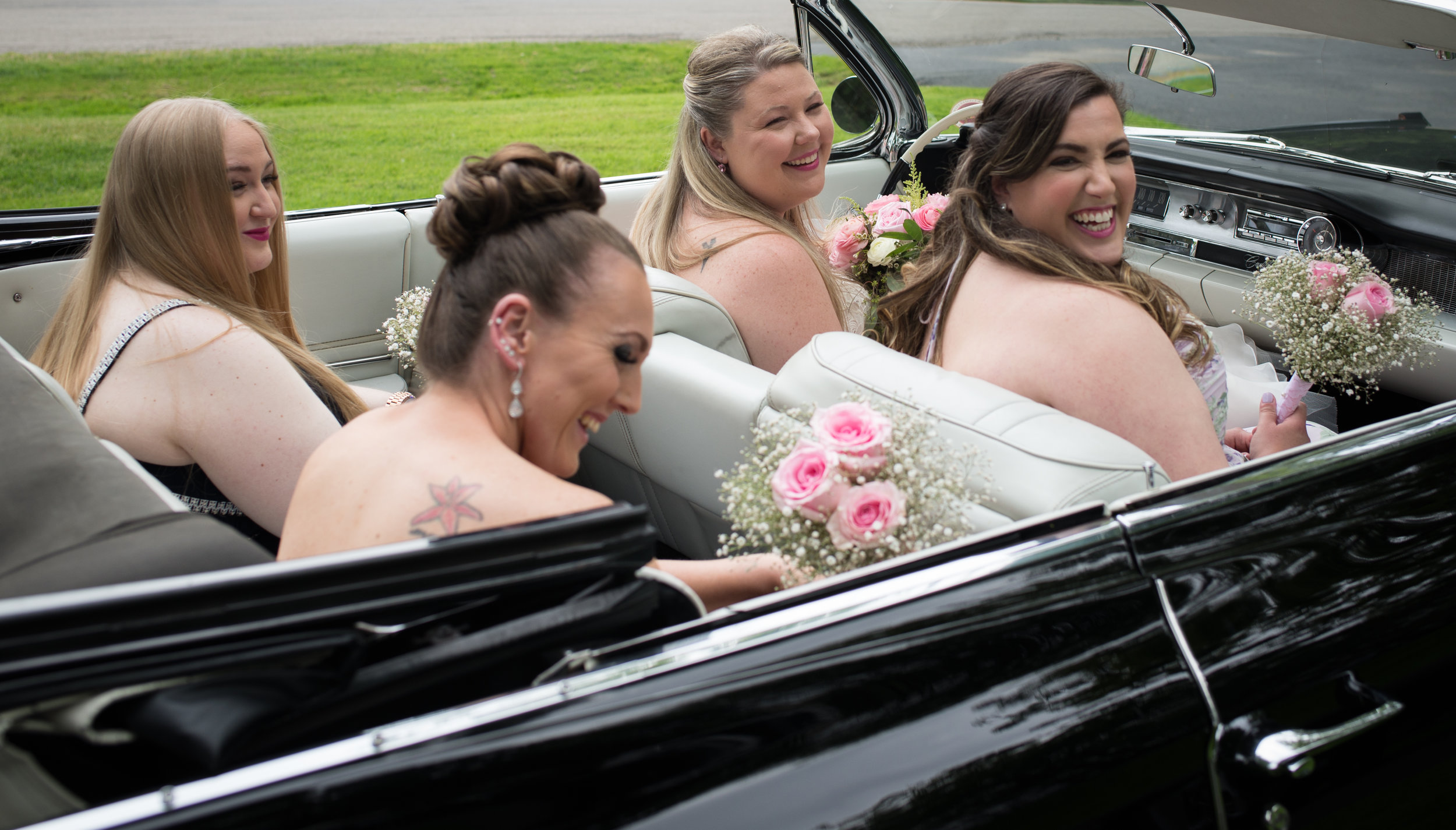 Bride and Bridesmaids in Antique Car