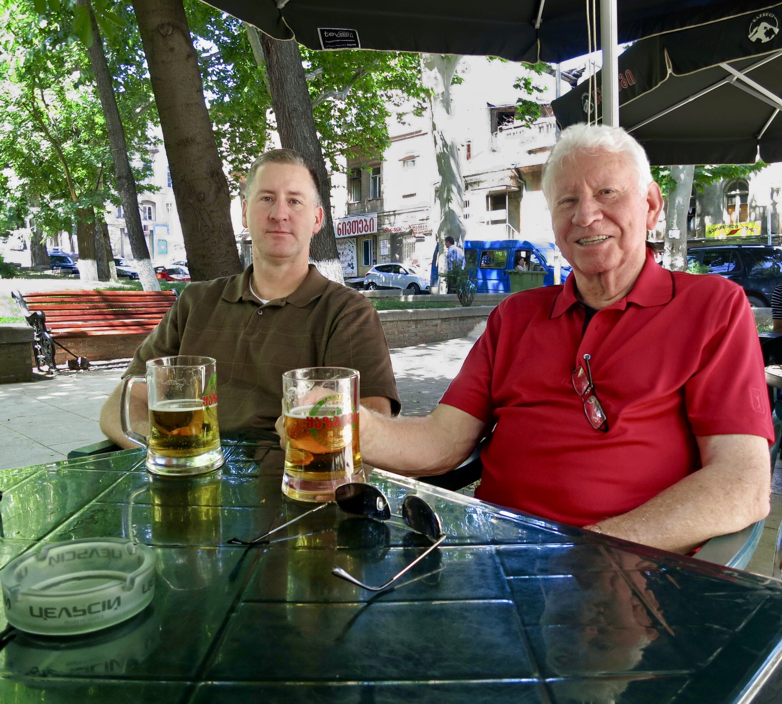 Sunday, June 16, 2013 (Father's Day). Me and my father in 9 April Park at the same establishment. I didn't know it then (although I had a strong suspicion) this would be my last visit to Georgia in my role at the time. Gaumarjos!