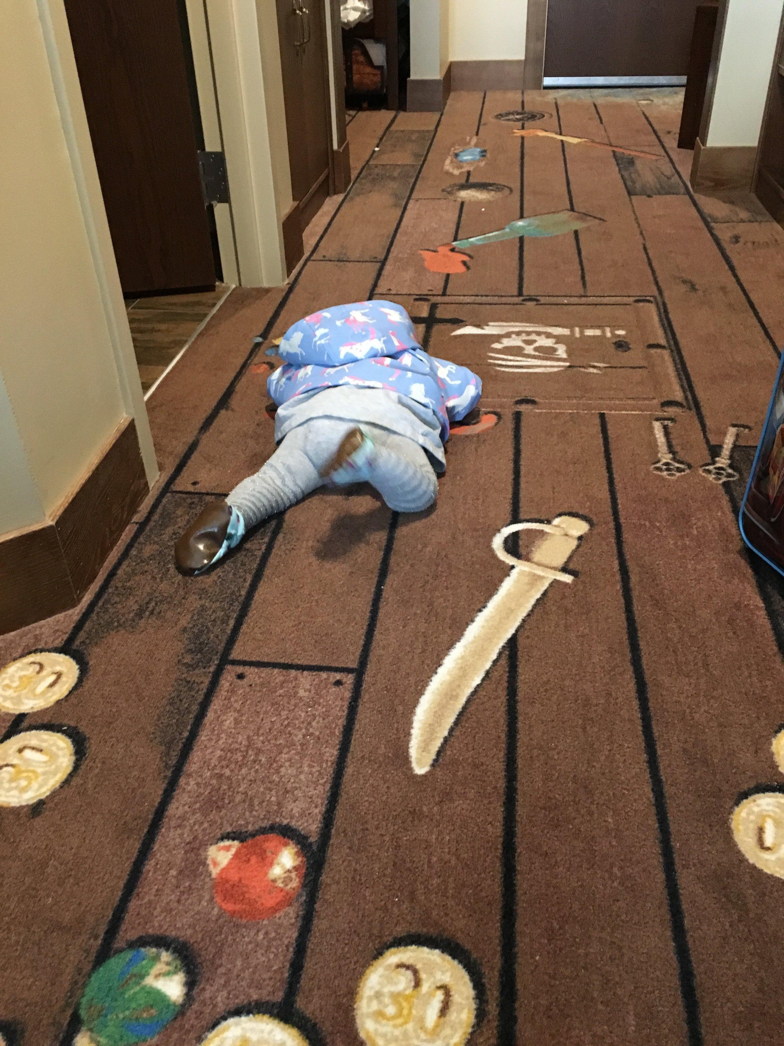Isla exhasuted on the pirate themed floor
