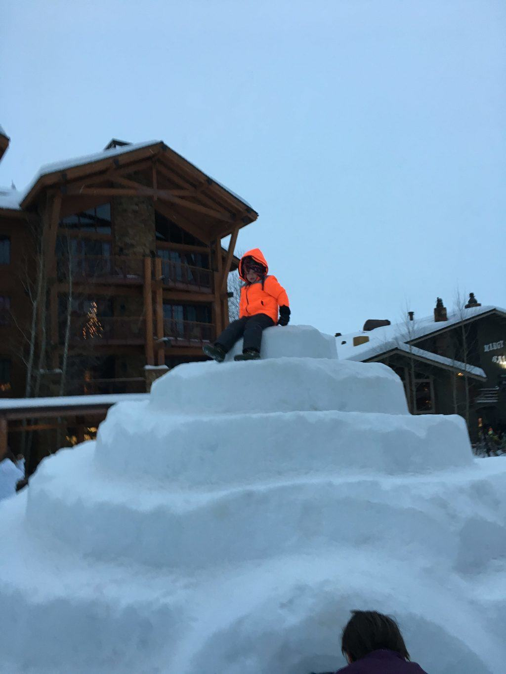 Graham on the top of the ice castle at the Jackson Hole Mountain Resort
