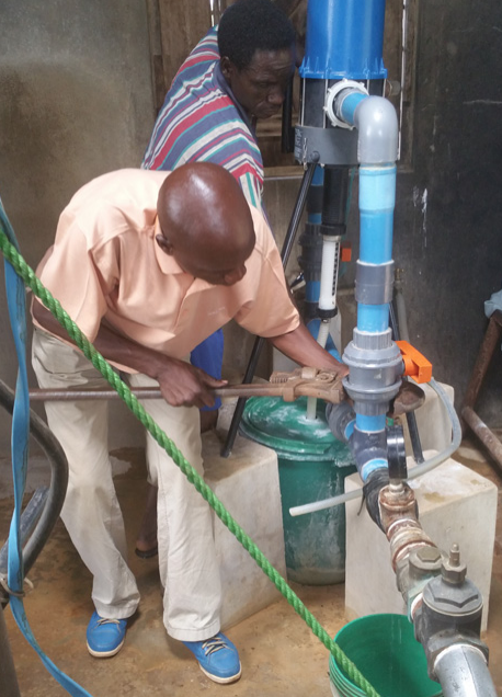 Installation of the dosatron in the pump house