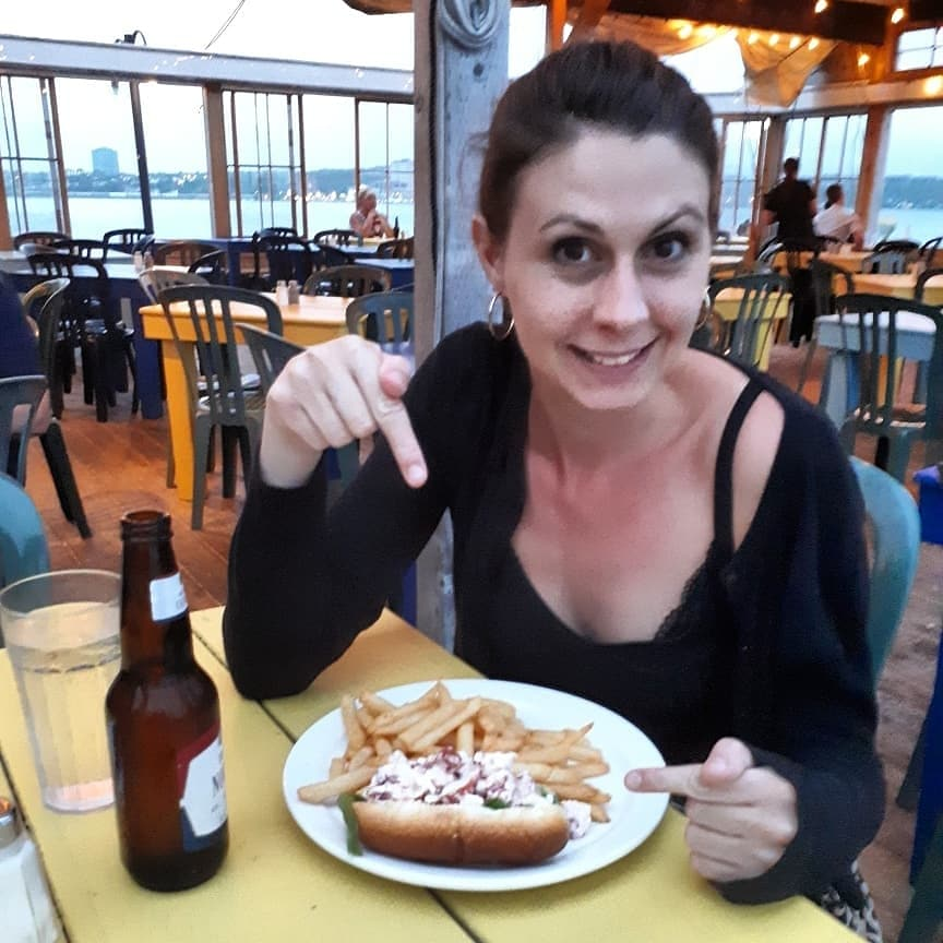 Naomi enjoying a lobster roll in Halifax, Nova Scotia