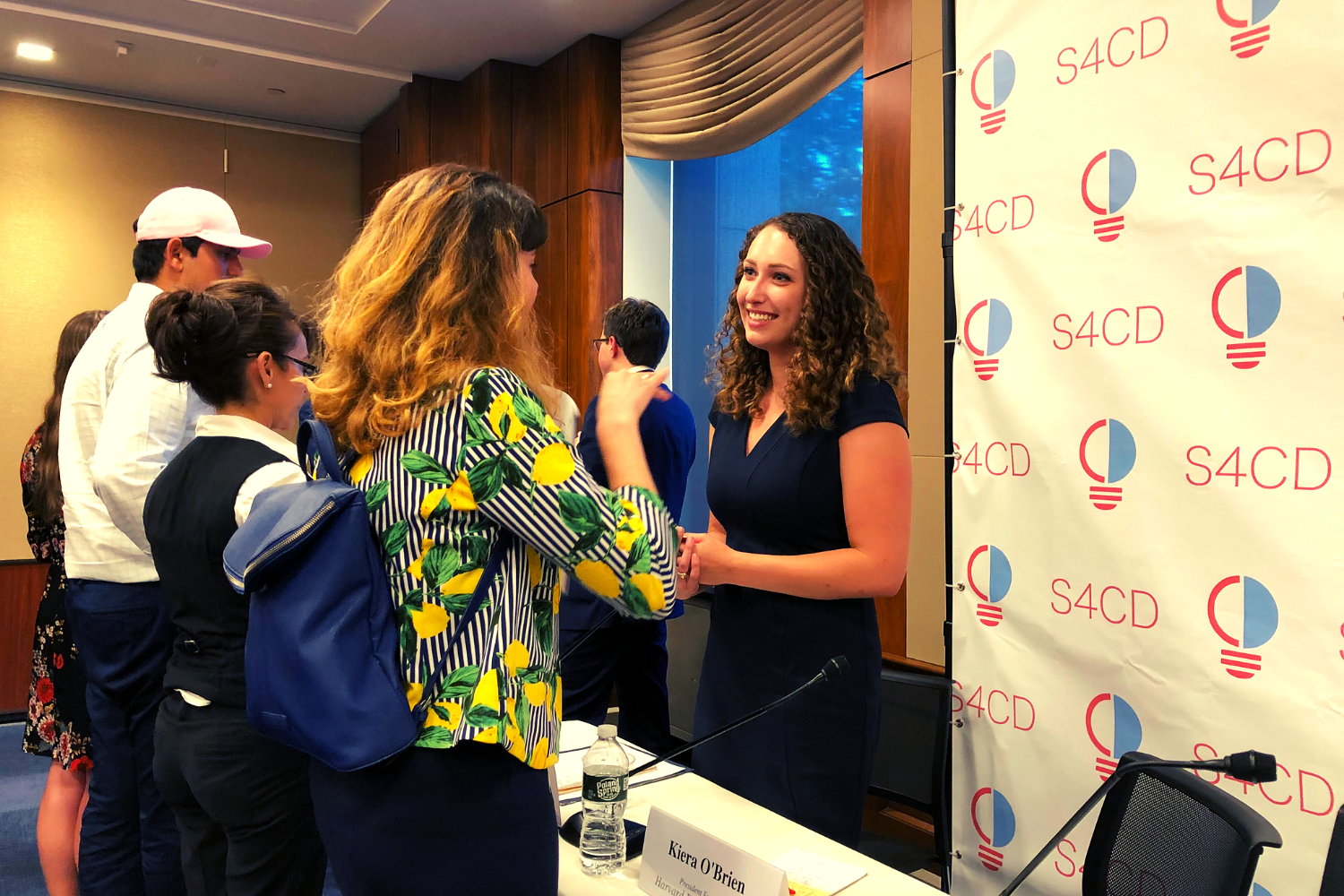 Our VP Kiera O'Brien interacting with attendees after the Congressional briefing.