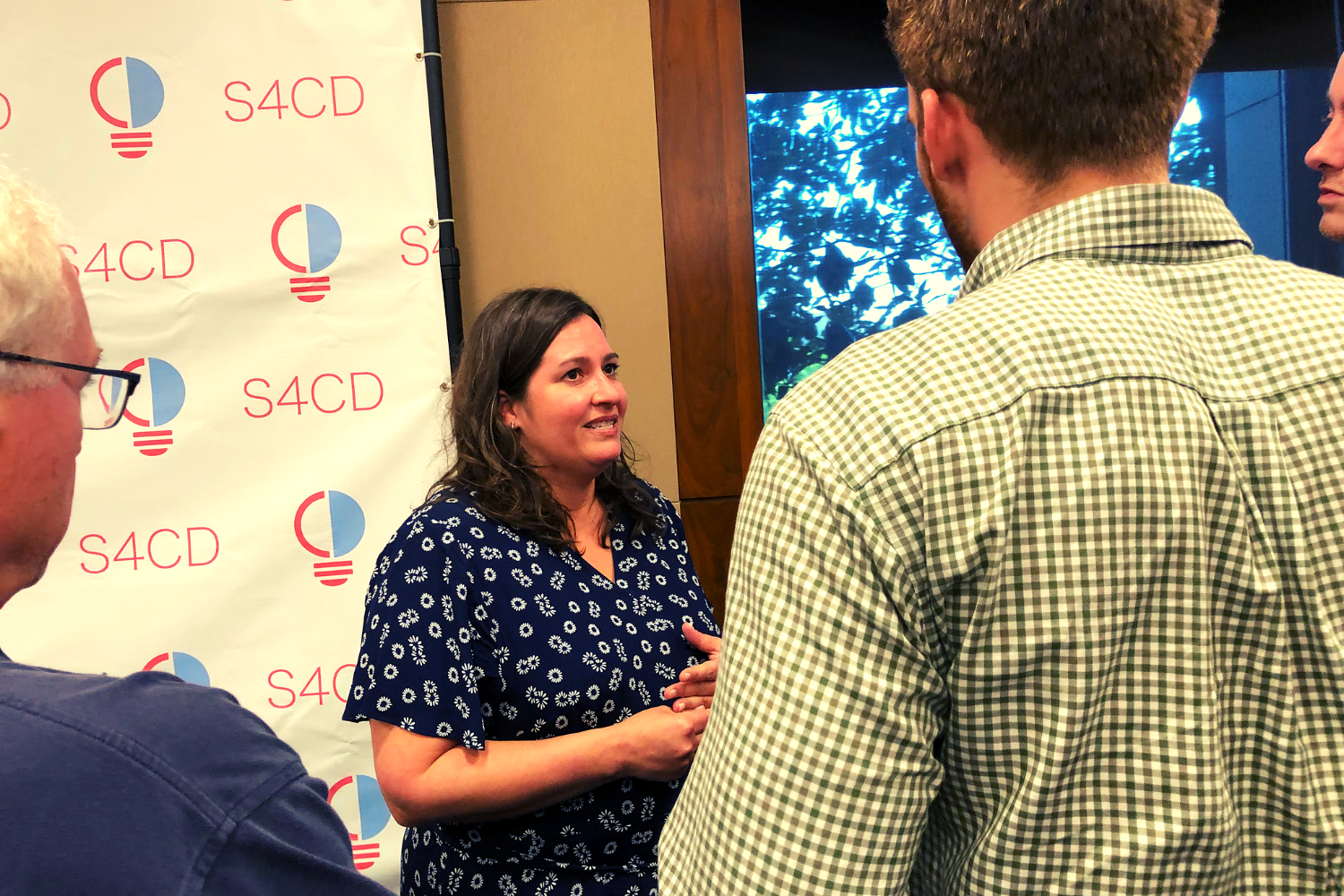 Beth Youra, VP of Luntz Global, interacting with attendees at S4CD's Congressional briefing.