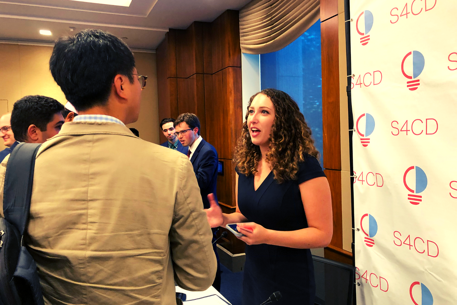 S4CD's VP Kiera O'Brien (and President Emerita of the Harvard Republican) interacting with attendees.