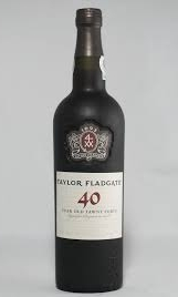 40 YR OLD TAWNY    Made entirely from the grapes grown on Taylor Fladgate's own properties, Taylor Fladgate is one of the few remaining houses which still produces a 40 Year Old Aged Tawny Port.    Tiny quantities of this wine are made. Decades of evaporation and ageing in wood have concentrated this wine almost to an essence, producing intense and complex nutty and spicy aromas and a dense and concentrated palate full of rich mellow flavour.
