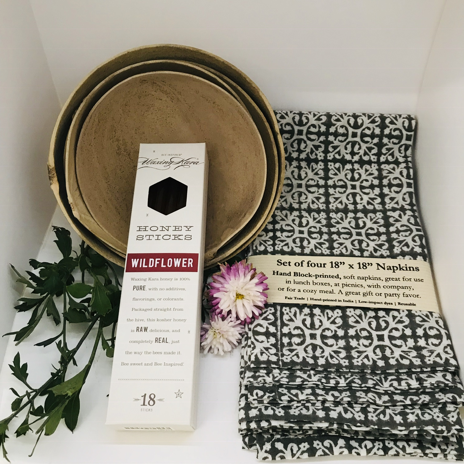 Gift for your Grandmother - Your grandmother will love this addition to dining room table with some custom napkins, gourd bowls, and honey sticks from Waxing Kara for her sweet tooth.